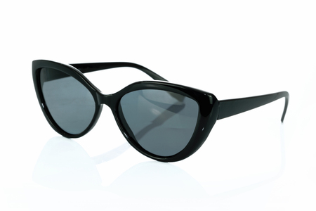 Trendy fashionable black sunglasses isolated on white background in close-up Stock Photo