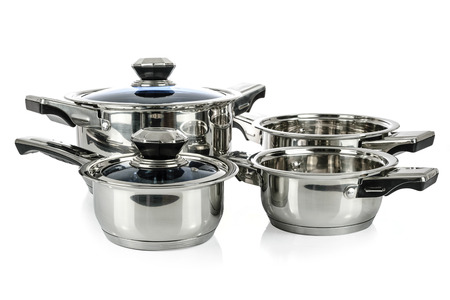 Group of premium stainless steel pots and pans isolated on a white background.