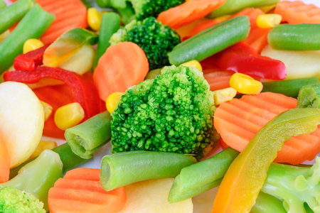 Mixed chopped fresh vegetables in close-up as a background Stock Photo