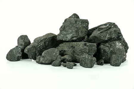 Concept of energy fuel - black coal in close-up isolated on a white background