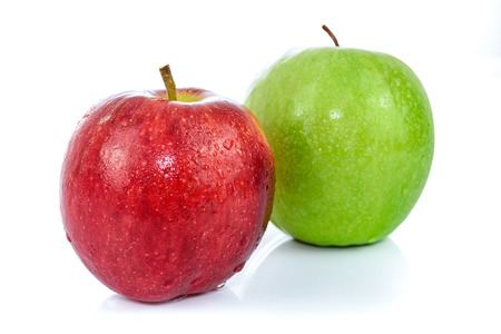 Two fresh apples in red and green color with drops of water and isolated on a white background.