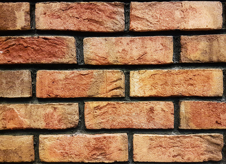 Old vintage brick wall background in close-up Stock Photo