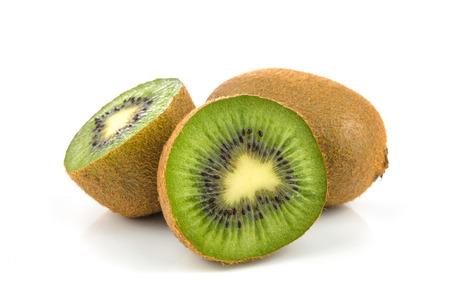 Group of kiwi fruits isolated on white background in close-up Stock Photo