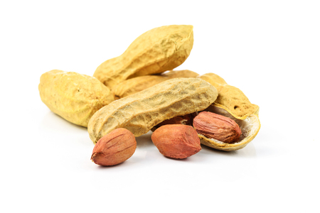 Dried peanuts isolated on the white background in close-up Stock Photo
