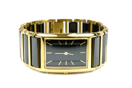 Elegant female gold watch isolated on a white background in close-up