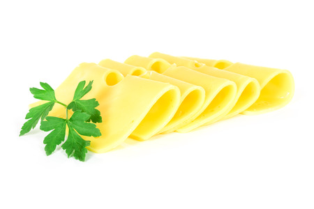Pieces of fresh yellow cheese with parsley isolated on a white background in close-up. Stock Photo