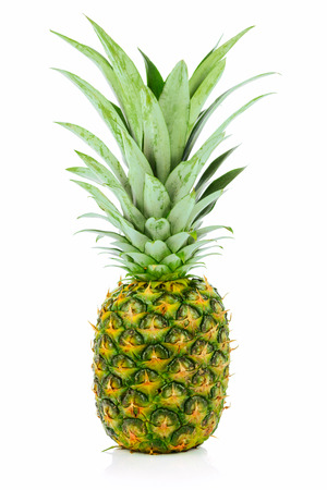 Single ripe and whole pineapple isolated on a white background