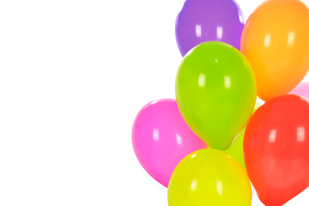 Party decoration concept - mix of colorful balloons isolated on a white background with copy space.
