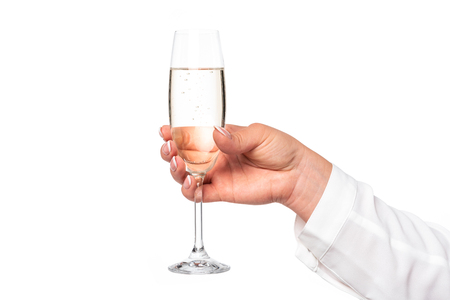 Beautiful and perfect female hand holding a glass of champagne or wine isolated on a white background in close-up Stock Photo