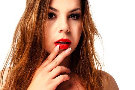 Close up of a beautiful and sensual young woman portrait with long hair and perfect fingernails (vintage effect).