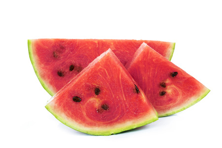 Slices of a fresh and ripe watermelon isolated on a white background in close-up. Stock Photo