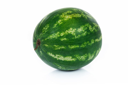 Single whole watermelon isolated on a white background in close-up