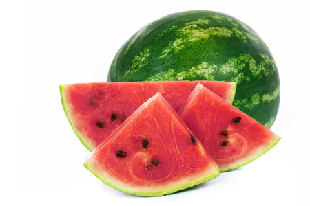 Slices and whole part of a fresh and ripe watermelon isolated on a white background in close-up.