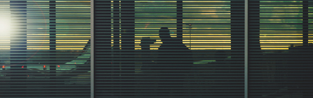 Airport terminal banner background - passengers board an airplane in the evening