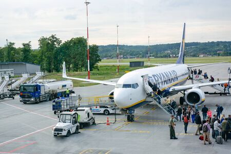 Krakow, Poland - June 25, 2018: Travelers boarding Ryanair Boeing 737 in Krakow Balice Airport. Ryanair is a large Irish low-cost airline company. 에디토리얼