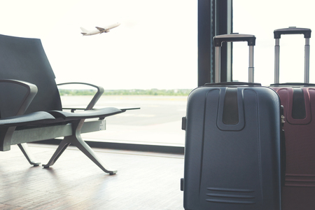 Travelling concept - big travel suitcases in the airport lounge Stock Photo