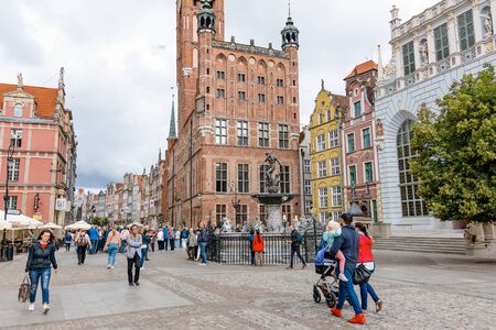 Gdansk, Poland - June 26, 2018: Tourists visiting old town of Gdansk with the Neptune Fountain and City Hall