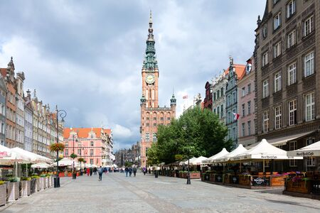 Gdansk, Poland - June 26, 2018: Tourists visiting famous Dluga Street in old town of Gdansk with the Neptune Fountain and City Hall.