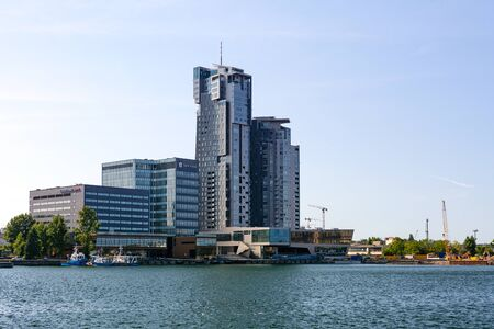 Gdynia, Poland - July 28, 2018: Cityscape with the port wharf and modern architecture buildings.Port of Gdynia is famous Polish seaport located on the coast of Baltic Sea