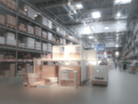 Industrial background - blurred interior view of a large warehouse or logistic corporation with workers Stock Photo