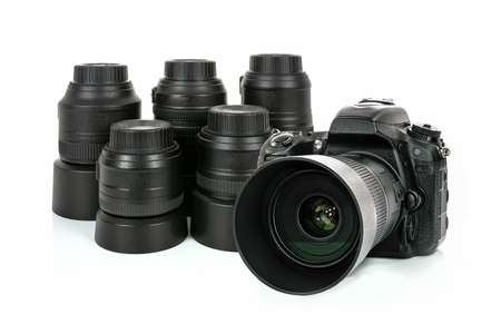 Collection of professional and modern lenses and DSLR camera isolated on a white background in close-up
