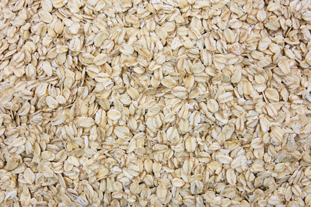 Top view of oatmeal flakes in close-up as a background or full frame texture (high details)