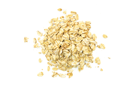 Top view of oatmeal flakes on a white background Stock Photo