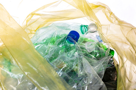 Environmental conservation concept - empty plastic waste ready for recycling in a garbage bag