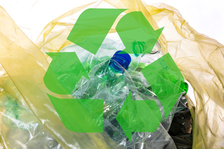 Environmental conservation concept - empty plastic waste in a garbage bag with recycle sign Stock Photo