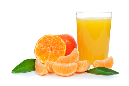 Tropical fruit composition - glass of fresh orange juice and pieces of orange or tangerine isolated on a white background Stock Photo