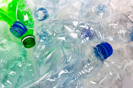 Environmental pollution concept - empty crumpled plastic bottles ready for recycling in close-up. Stock Photo
