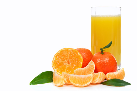 Tropical fruit composition - glass of fresh orange juice and pieces of orange or tangerine isolated on a white background (copy space) Stock Photo