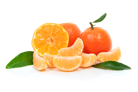 Tropical fruit composition - fresh  fruits and pieces of orange or tangerine with leaves isolated on a white background Imagens