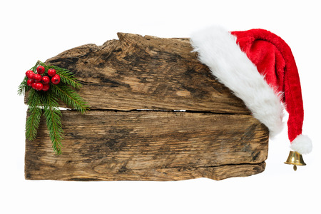 Christmas template - old wooden sign with Santa hat and spruce twig on white background