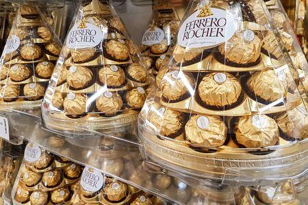 Nowy Sacz, Poland - December 07, 2018 : Ferrero Rocher premium chocolate on store shelf for sale in supermarket. Ferrero Rocher is a famous Italian chocolate produced.