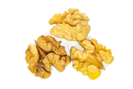 Top view of dry and shelled walnuts isolated on a white background