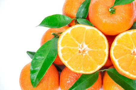 Tropical fruit composition - group of fresh oranges or tangerines  isolated on a white background