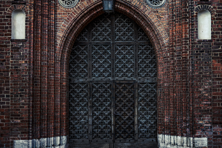 Big old wooden gates to a Gothic castle or cathedral (high details and hdr effect)
