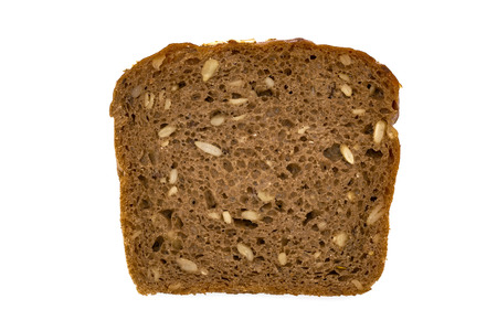 Slice of wholemeal dark bread isolated on a white background in close-up (high details) 免版税图像
