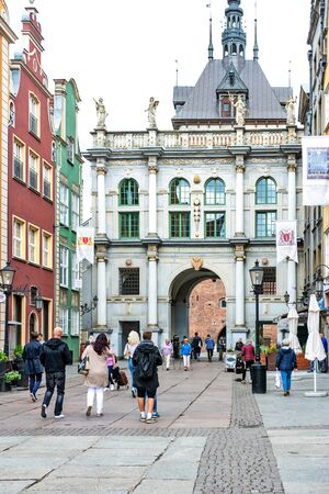 Gdansk, Poland - June 26, 2018: Tourists visiting famous Golden Gate in old town of Gdansk. 에디토리얼