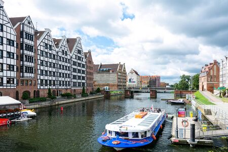 Gdansk, Poland - June 26, 2018: Tourist cruise ship on Motlawa river in historical Old Town of Gdansk City 에디토리얼
