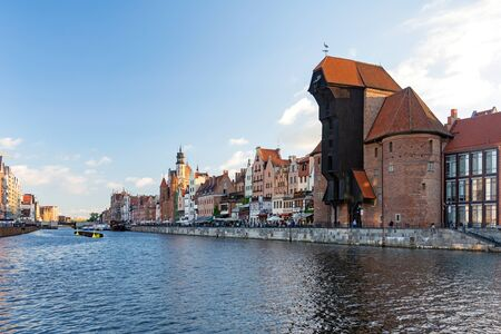 Gdansk, Poland - June 26, 2018: View of the old city of Gdansk on the Motlawa River and famous medieval port crane.