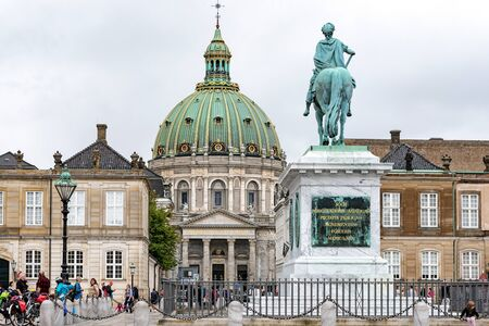 Copenhagen, Denmark - July 24, 2017: Tourists visiting Amalienborg Palace Square in Copenhagen with the statue of King Frederick V and Marble Church on the background. 에디토리얼