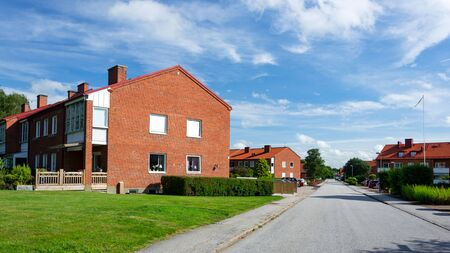 Veberod, Sweden - July 22, 2017:  Panoramic view of typical Swedish buildings multi-family houses in a small town and on the outskirts of the agglomeration.