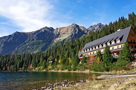 Popradske Pleso, Slovakia - October 15, 2017:  View of Tourist Shelter and lake in Popradske Pleso, National Park High Tatras Mountains in Slovakia on a sunny autumn day. 에디토리얼