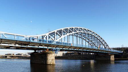 Krakow, Poland - February 16, 2019: Panoramic view of the Marshal Jozef Pilsudski bridge over Vistula river in Krakow