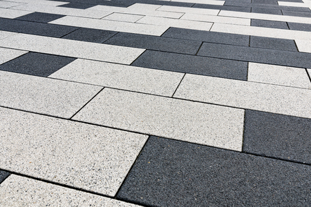 Architecture industry full frame background - sidewalk of concrete tiles in close-up ( high details)