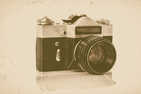 Archival view of a professional retro analog SLR  camera isolated on white background ( vintage effect) Stock Photo