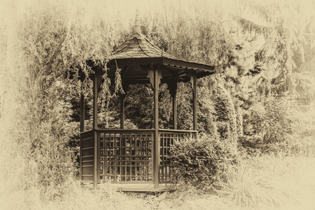 Archival pagoda in a Japanese garden among trees and plants (vintage retro effect). Stock Photo