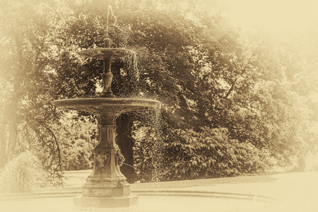 Archival and historical fountain in the public park  (vintage effect).